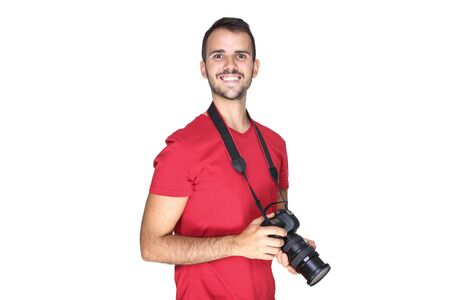 Young photographer with camera on white background