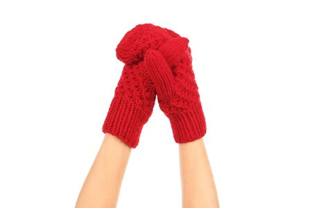 Hand in knitted mitten on white background Stock Photo
