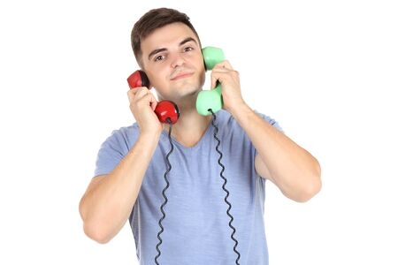 Young man with handsets on white background