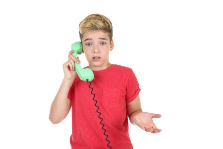Young boy with handset on white background
