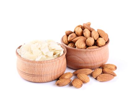 Almonds in bowls isolated on white background Imagens