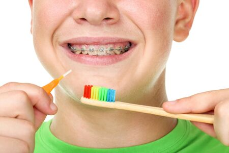 Young man with toothbrushes on white background