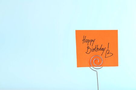 Paper with text Happy Birthday on blue background