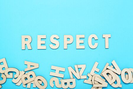 Word Respect by wooden letters on blue background