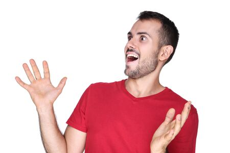 Young surprised man on white background