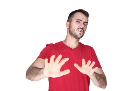 Portrait of young beard man showing stop gesture isolated on white background