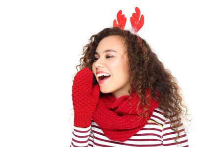 Beautiful american woman wearing red horns, scarf, gloves and screaming isolated on white background Stock fotó