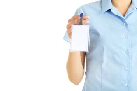 Female hand showing blank bagde on white background Stock Photo