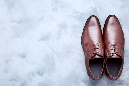 Male leather shoes on grey background