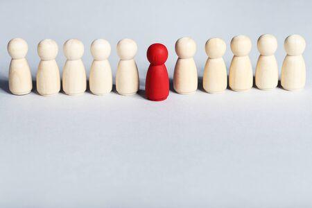 Leader concept. Wooden figures on grey background