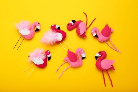 Soft toy of flamingos on yellow background 版權商用圖片