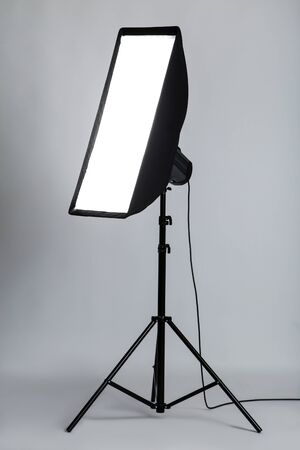 Studio lighting with softbox on grey background