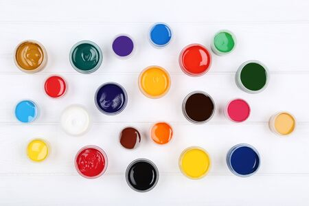 Colorful gouache paints on white wooden table Banco de Imagens - 138293271