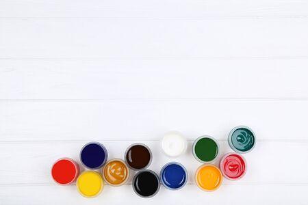 Colorful gouache paints on white wooden table Banco de Imagens - 138293199