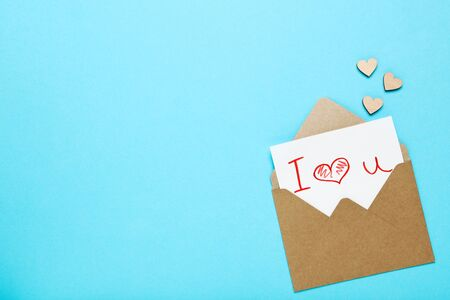 Paper envelope with hearts and text I Love You on blue background