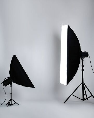 Studio lighting with softboxes on grey background