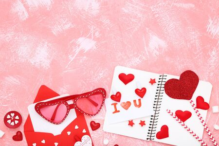 Valentine hearts with sunglasses, envelope and text I Love You on coral background Banco de Imagens