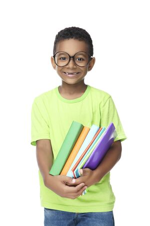 Young African American school boy with books and notepads on white background