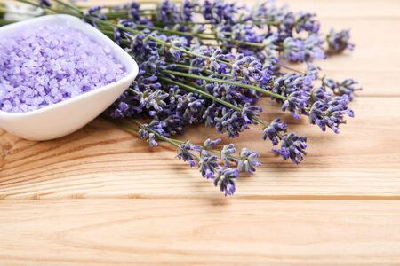 Lavender flowers and spa salt on brown wooden table Reklamní fotografie