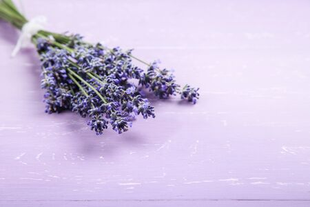 Lavender flowers on purple wooden table