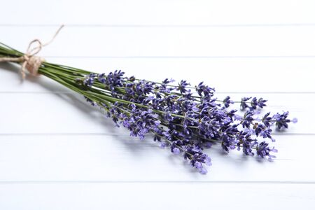 Lavender flowers on white wooden table