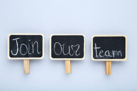 Text Join Our Team on black chalkboards