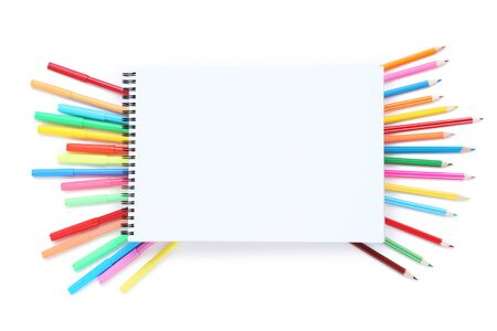 Colorful pencils and felt-tip pens with blank sheet of paper on white background