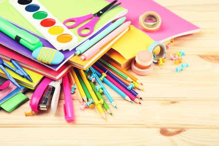 School supplies on brown wooden table Zdjęcie Seryjne