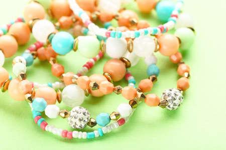 Beautiful bracelets on green background