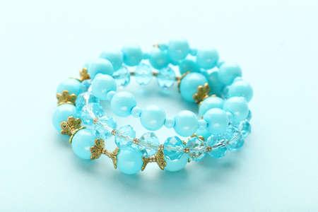 Beautiful blue bracelets on blue background