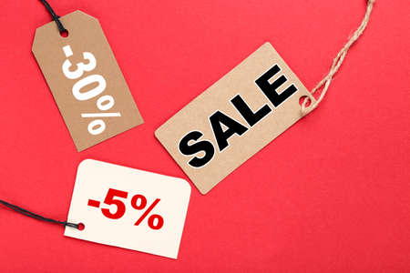 Sale tags with word Sale, 5 and 30 percents on red background 版權商用圖片