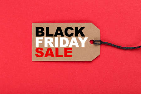Sale tag with text Black Friday Sale on red background
