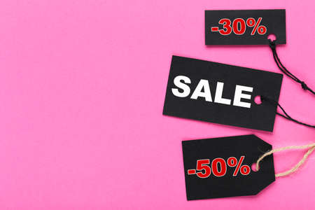 Sale tags with word Sale, 30 and 50 percents on pink background