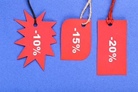 Sale tags with percents on blue background