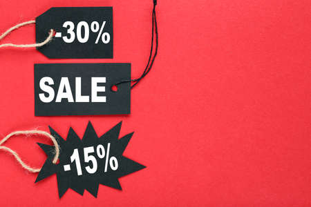 Sale tags with text Sale, 15 and 30 percents on red background