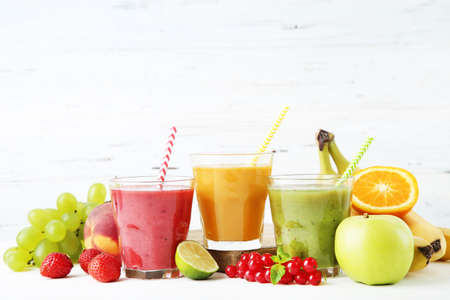 Healthy smoothie in glasses with fruits and vegetables on wooden background Reklamní fotografie