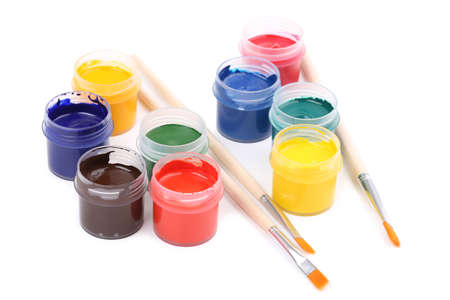 Colorful gouache paints and brushes isolated on white background