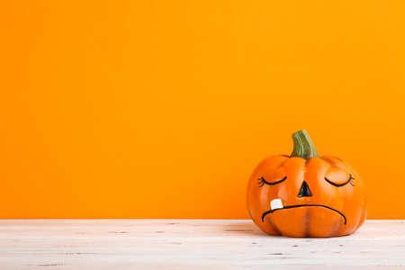 Halloween pumpkin on orange background Standard-Bild