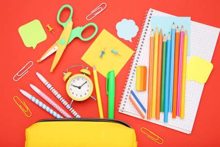 School supplies on red background