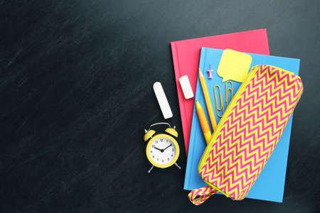 School supplies on black background Standard-Bild