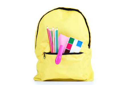 Backpack with school supplies isolated on white background