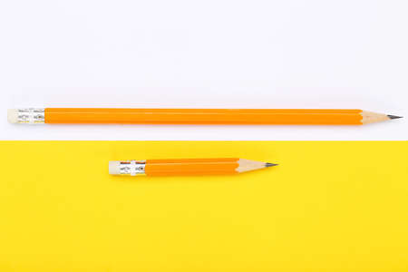 Yellow pencils on colorful background