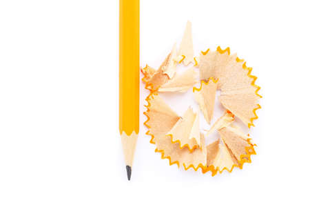 Yellow pencil with shavings on white background Standard-Bild