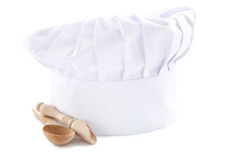 Chef hat with wooden spoon and scoop isolated on white background