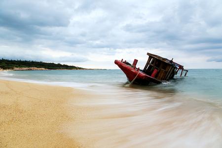 stranded: Stranded boat at beach Stock Photo