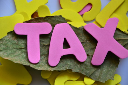 TAX WORD Stock Photo