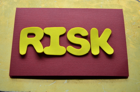 word risk on abstract background Imagens