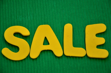 word sale on an green background