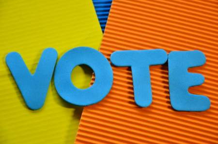 word vote on an abstractly colored background 写真素材