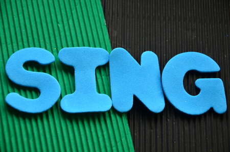 word sing on an abstract background Stock Photo - 104202720